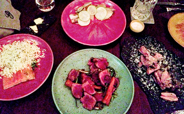 dinner at Gustu (clockwise from top: soft pig belly with onions and pears; lama loin with apple banana and carmelized chuño; aged beef, spring onions and fermented carrots; shredded potato Huaycha, poached trout and coa)