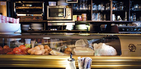 the small bar counter where most of Cafe La Fusée's food is made (photo courtesy of HG2 Paris)